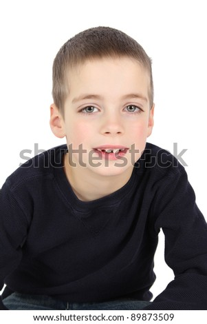 Portrait of cute brunette boy against white background