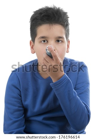 Portrait of cute child using asthma inhaler isolated on white background - stock photo