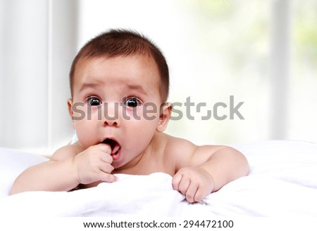 portrait of cute expressions from adorable little baby with copy space - stock photo