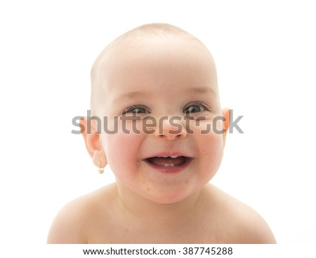 Portrait of cute female infant on white background.