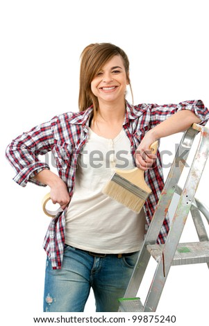 Portrait of cute female painter with brush ready to paint.Isolated on white. - stock photo