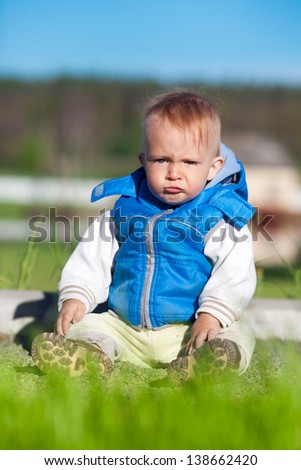 portrait of cute funny angry  little boy - stock photo