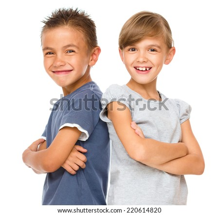 Portrait of cute girl and boy, isolated over white - stock photo