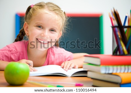 Portrait of cute girl at workplace with the apple - stock photo