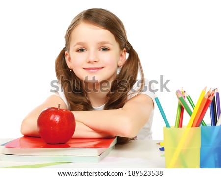 Portrait of cute girl at workplace with the books - stock photo