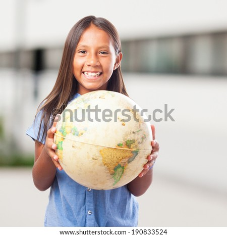 portrait of cute girl holding a world globe - stock photo