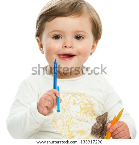 Portrait of cute girl holding color wax crayons.isolated. - stock photo