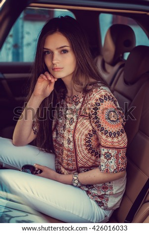 Portrait of cute girl in a car.