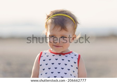 portrait of cute girl in sunset light