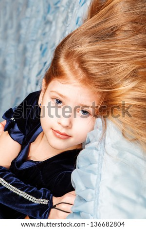 Portrait of cute girl lying in the bed