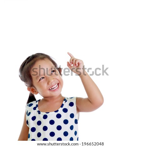 Portrait of cute girl point up - stock photo