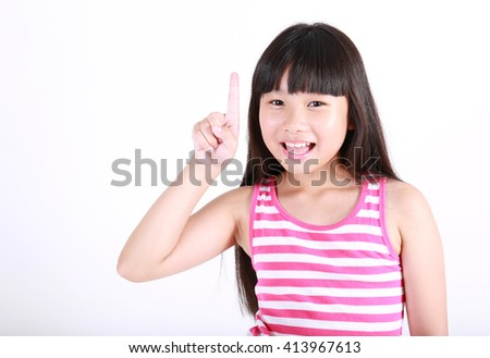 Portrait of cute girl point up