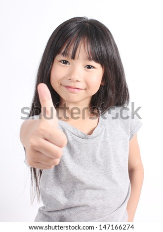 Portrait of cute girl thump up - stock photo