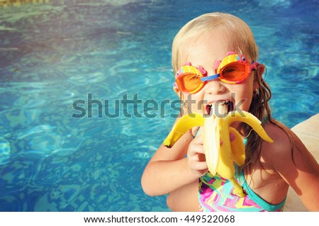 Portrait of cute girl with banana