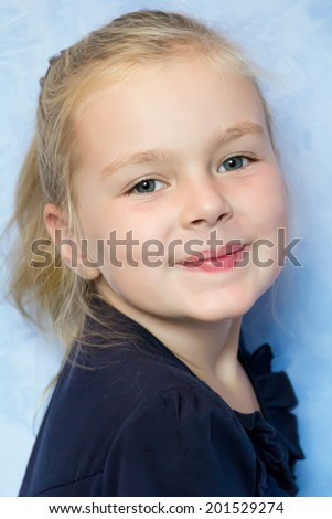 Portrait of cute girl with blond hair - stock photo