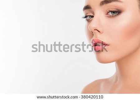 Portrait of cute girl with contemtated expression of her face - stock photo
