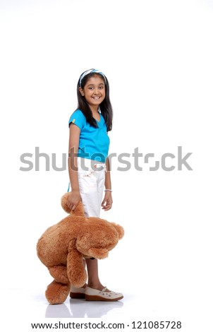 Portrait of cute girl with her teddy bear over white background
