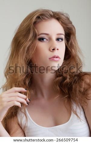 Portrait of cute gray-eyed girl posing at camera - stock photo