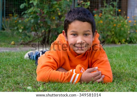 Portrait of cute gypsy  child boy happy smiling