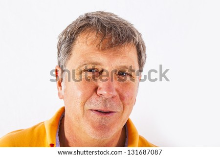 portrait of cute handsome man with a positive friendly expression