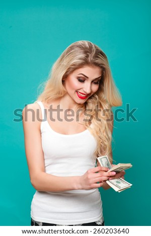 Portrait of cute happy girl holding in hand a lot american dollars, - stock photo