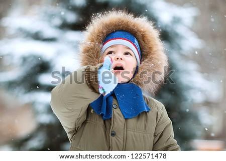 Portrait of cute happy  little boy in winter time - stock photo