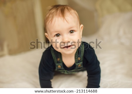 Portrait of cute happy 8 month old baby boy - stock photo