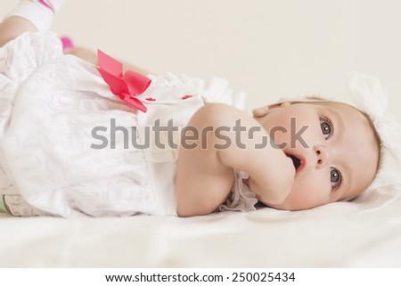 Portrait of Cute Infant Caucasian Female Child. Against White. Horizontal Image - stock photo
