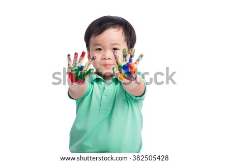 portrait of cute kid playing with paint - stock photo
