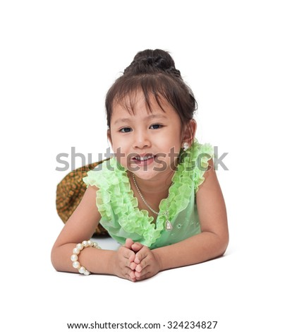 portrait of cute little asian girl wearing thai dress in thai's respect gesture, isolate on white (focus on face)