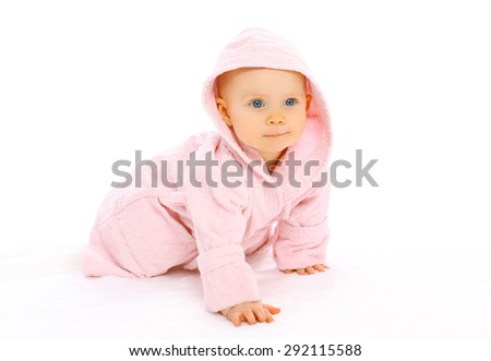 Portrait of cute little baby crawls in the pink bathrobe - stock photo