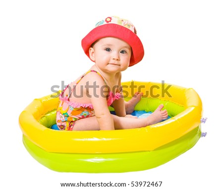Portrait of cute little baby girl in the swimming pool