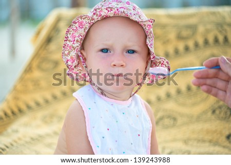 Portrait of cute little baby girl on the beach - stock photo