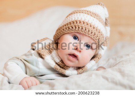 Portrait of cute little baby in knitted hat - stock photo