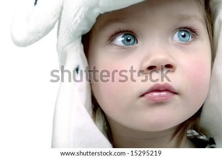 Portrait of cute little baby in white hat - stock photo
