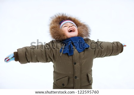 Portrait of cute little boy in winter time - stock photo