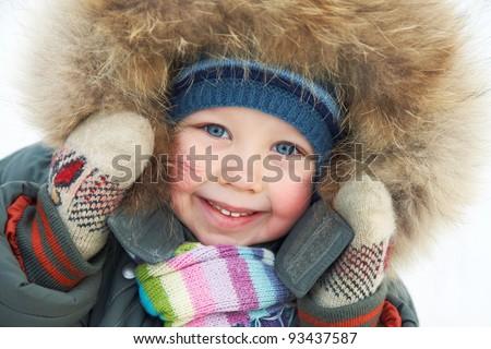 Portrait of cute little boy in winter time - stock photo