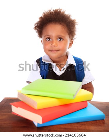 Portrait of cute little boy wearing school uniform with many colorful books isolated on white background, doing homework, back to school concept - stock photo