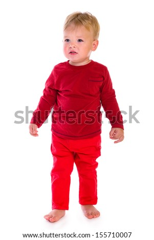 portrait of cute little caucasian baby standing at full height. isolated on white background. baby 1 year