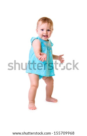 portrait of cute little caucasian girl standing full-length isolated on white background. baby 10 months