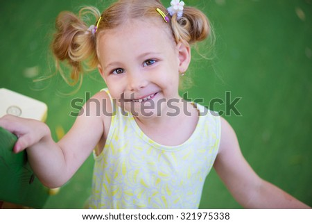 Portrait of cute little girl at playground - stock photo
