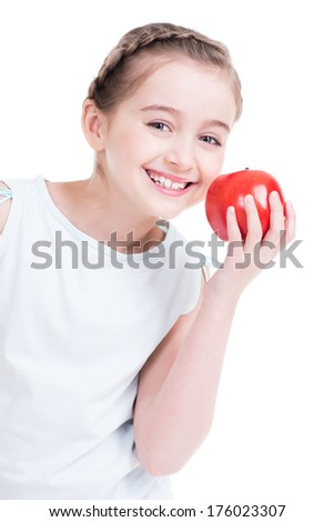 Portrait of cute little girl holding an apple - isolated on white.