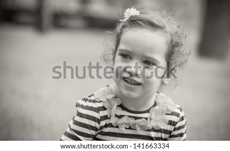 Portrait of cute little girl in a park. Close-up of beautiful child, outdoors sepia - stock photo