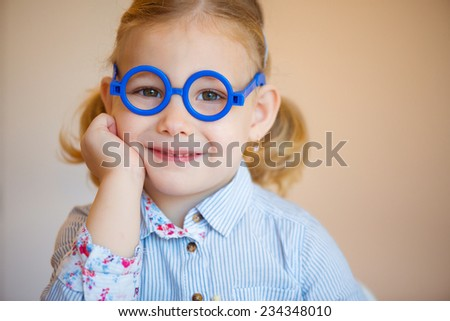 Portrait of cute little girl in glasses - stock photo