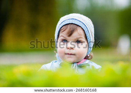 Portrait of cute little girl in nature.  Girl looking at camera. Selective focus, shallow depth of field. Creamy background. - stock photo