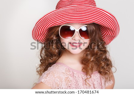 Portrait of cute little girl in summer hat and sunglasses,glamour child in panama hat and sun glasses trendy look. Happy Kid fashion summer. Isolated in studio, white background. - stock photo