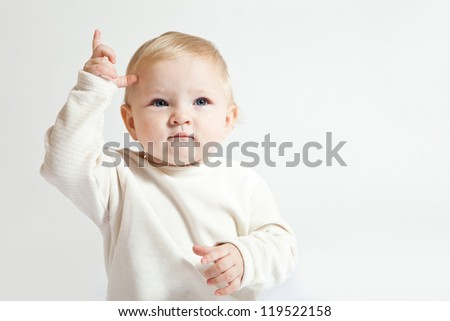 Portrait of cute little girl in white clothes - stock photo