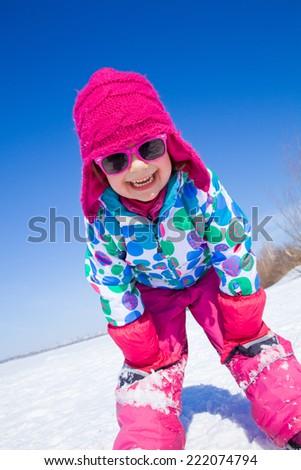 Portrait of cute little girl in winter - stock photo