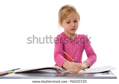 Portrait of cute little girl is drawing with pencil - stock photo