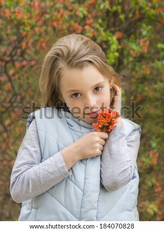 portrait of cute little girl on a background of spring flowers